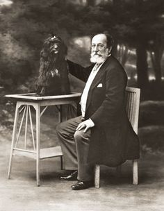 Saint-Saens, Camille French composer, Paris 9.10.1835 ñ Algiers 16.2.1921. Camille Saint-Saens with dog. Studio photograph, undated.